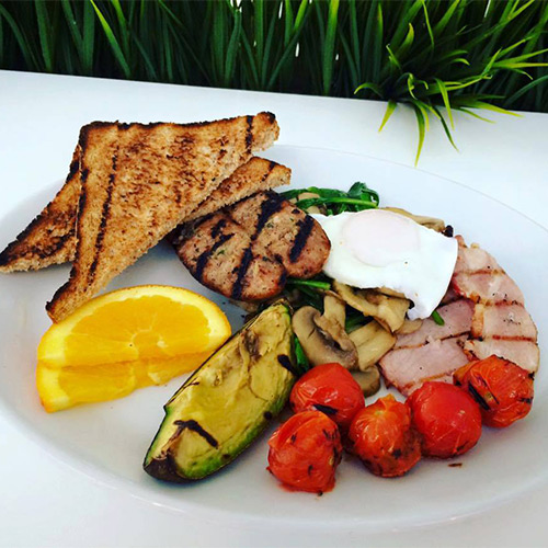 full breakfast with bacon, egg and grilled avocado at pure kitchen cardiff bay available with the discount voucher