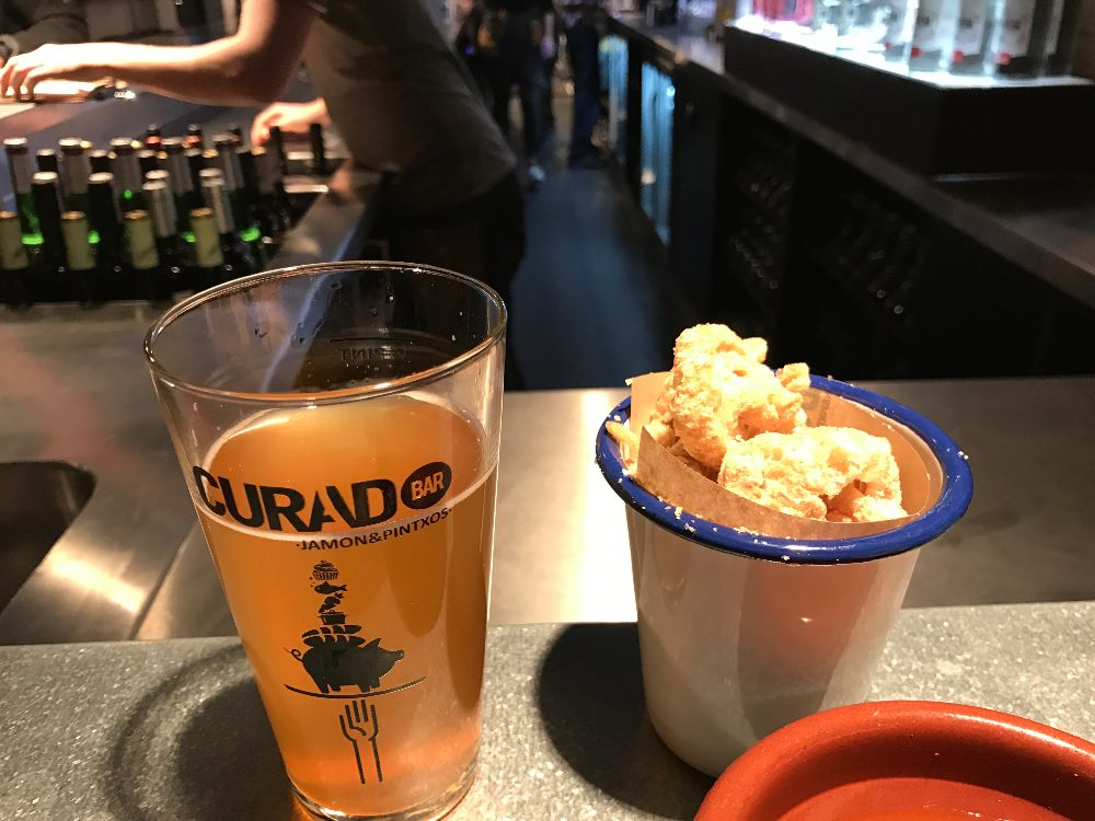 pork scratchings and Spanish beer Curado Cardiff
