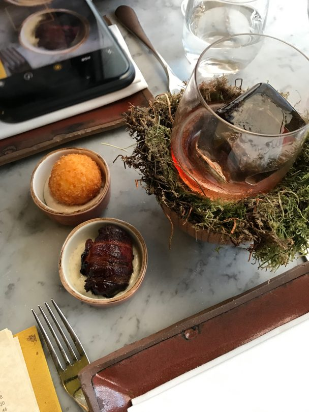 bacon wrapped dates and crispy polenta Duck and Waffle London