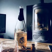 Welsh sparkling wine with log burner at The Corran Resort