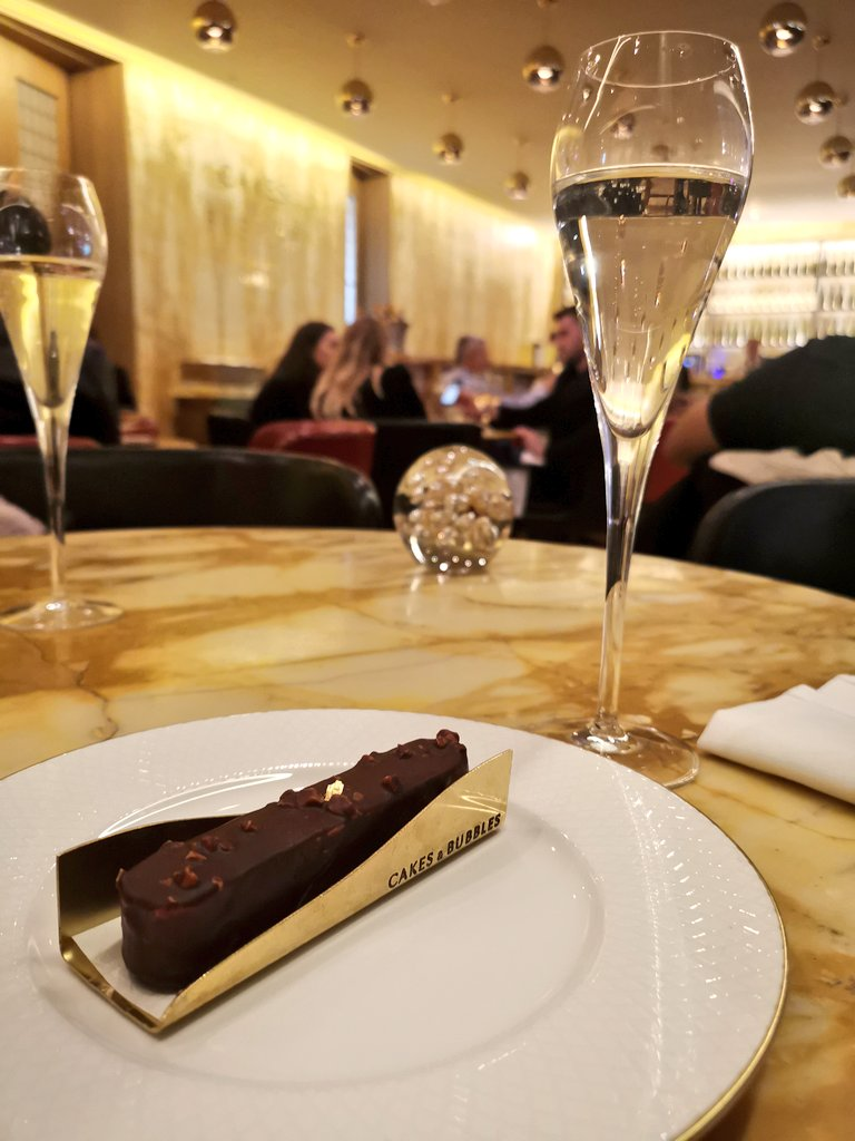 Chocolate and praline eclair at Cakes and Bubbles - Hotel Cafe Royal Review London