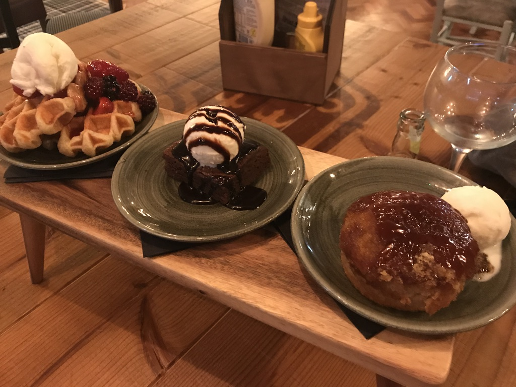 Sharing desserts at Head of Steam Cardiff