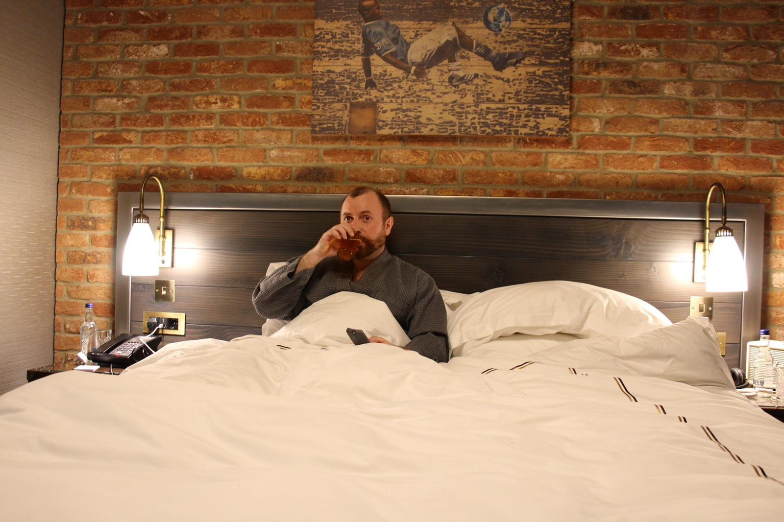 Me in bed at The Curtain Hotel Shoreditch - London
