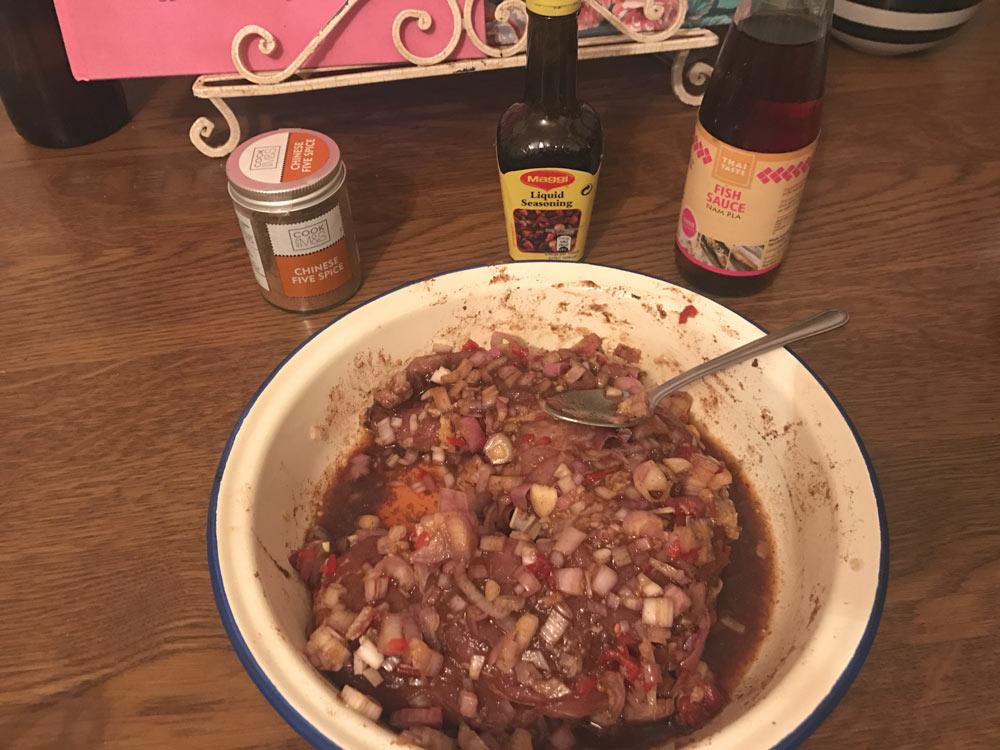 pork bahn mi marinading in seasoning