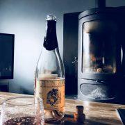 Welsh sparkling wine with log burner at The Corran Resort